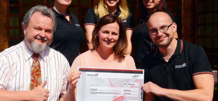 Opelaner spenden Pfandgeld für Kinderkrebshilfe