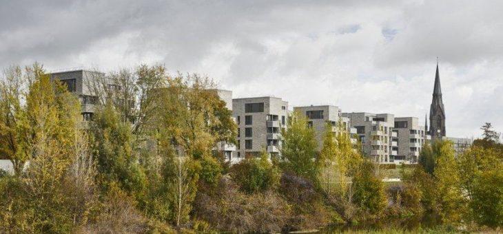 Grünes Wohnen am Fluss und nahe der Stadt